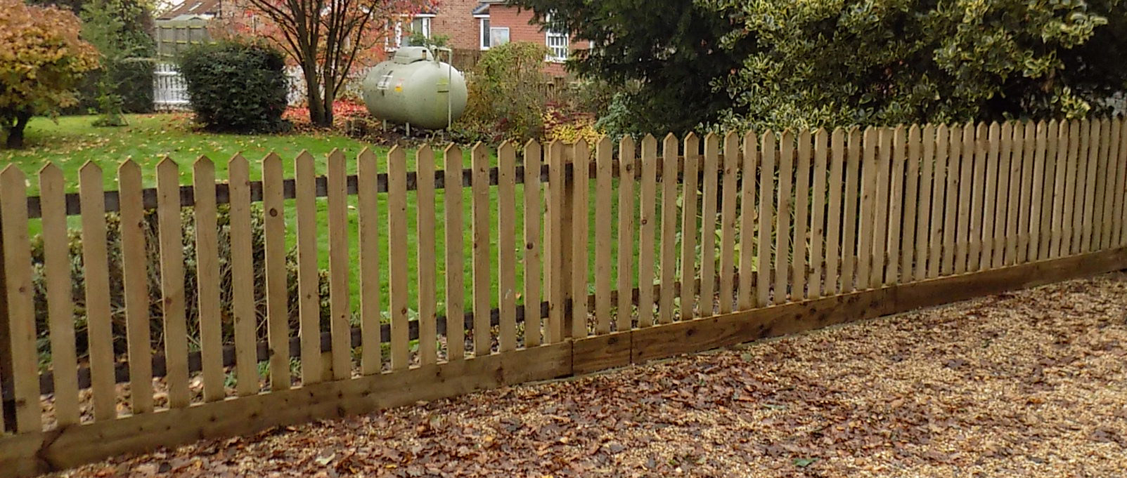 Palisade Fencing With Gravel Board Made In Suffolk