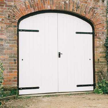 Curved top garage doors