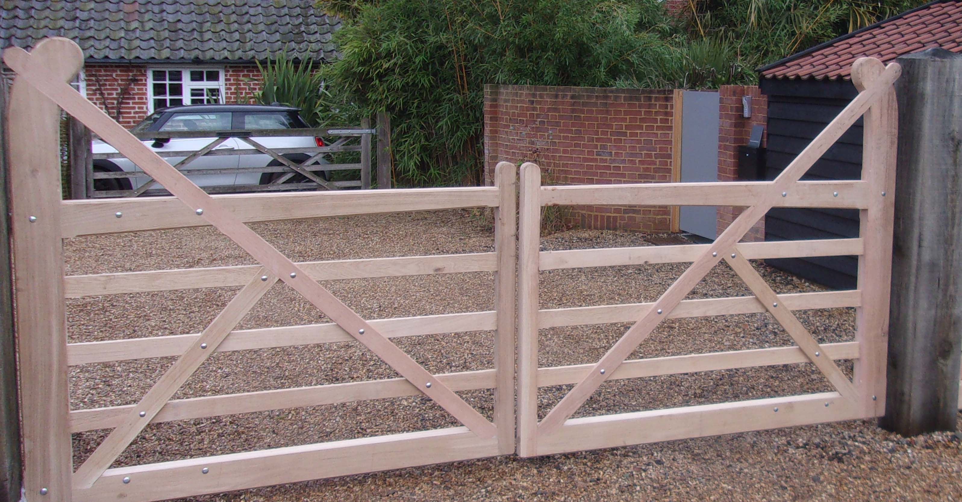 Equal pair of Oak Butley gates with solid base rails