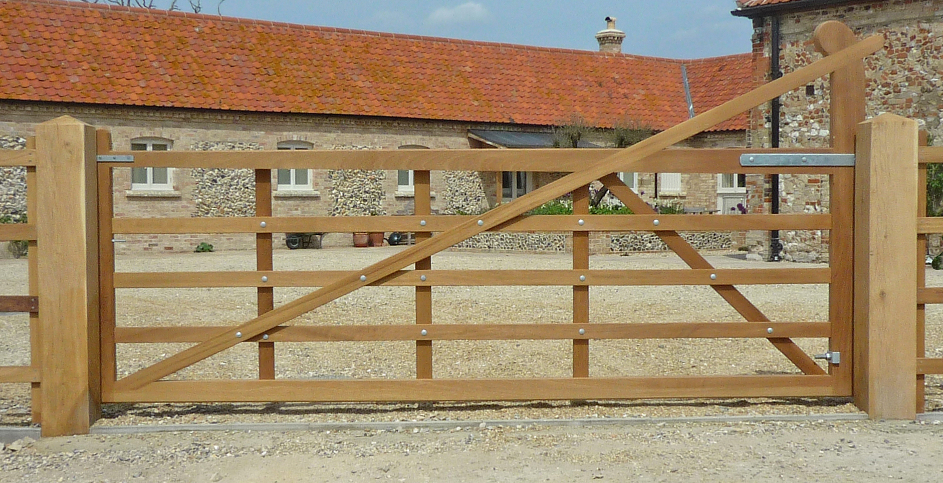 Butley gate in Iroko with a solid base rail