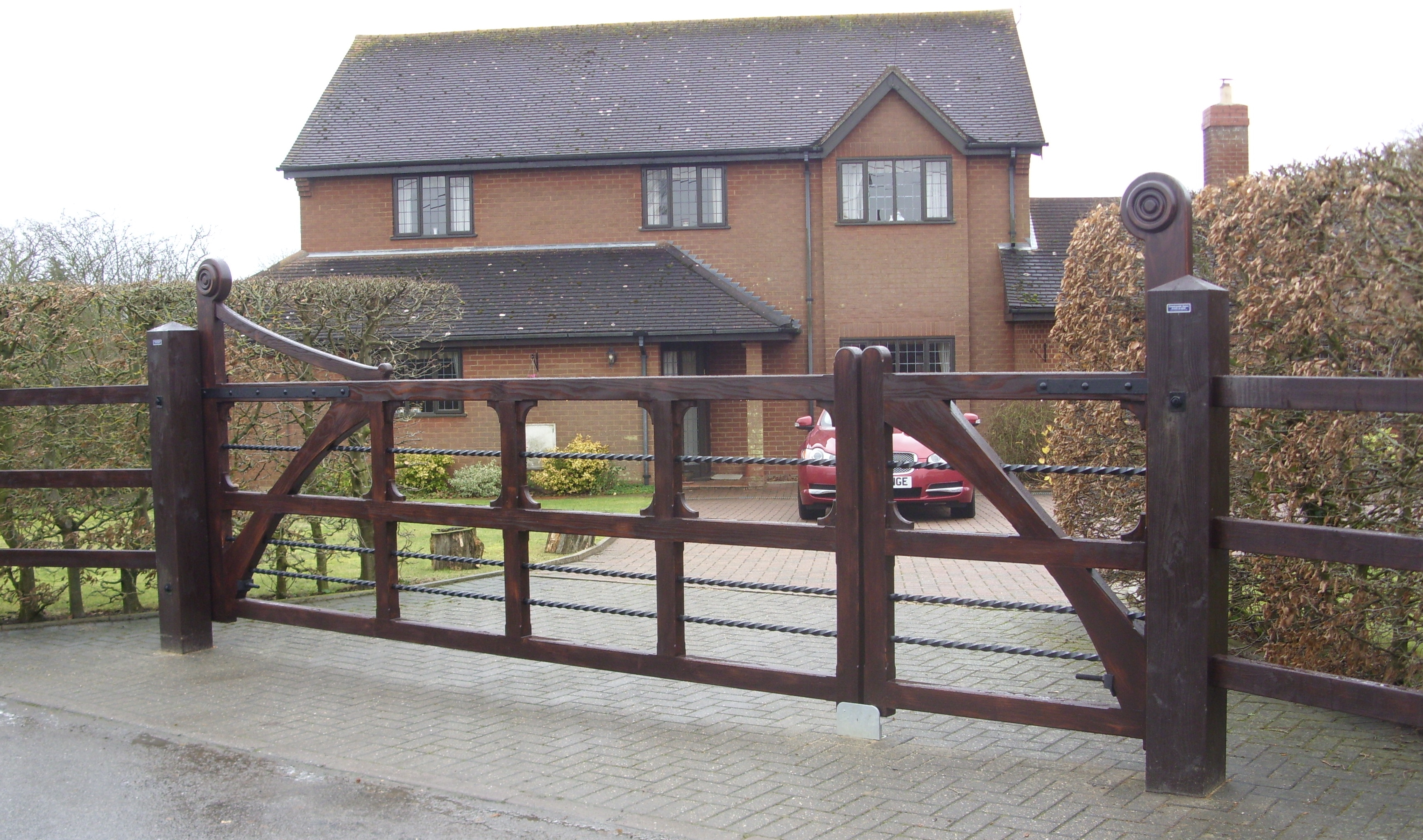 Orford gate made from Douglas fir and finished in Sadolins Extra Jacobean Walnut.