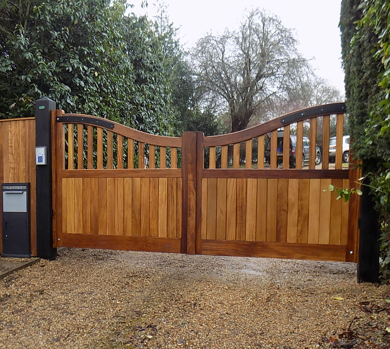 St Edmundsbury gates in oiled Iroko but with Douglas fir posts finished in black Barn paint