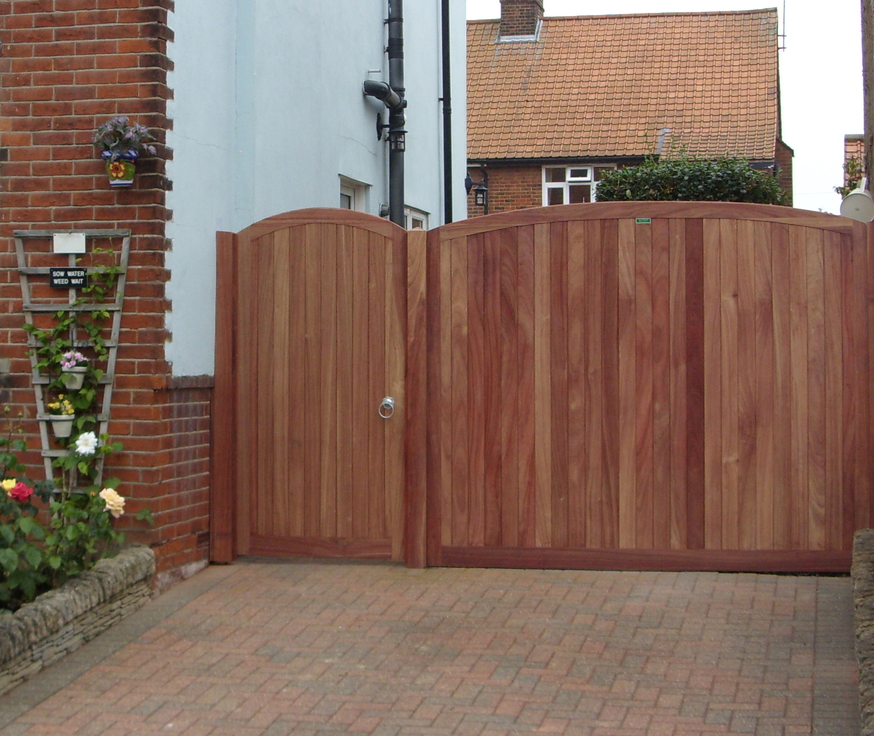 Needham pedestrian gate with matching side panel in Padauk